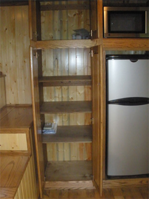Pantry and appliance cabinet open