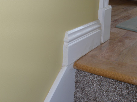 Baseboard with mitered return